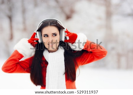 Happy Winter Woman With Wireless Headphones - Beautiful girl listening to music outside
