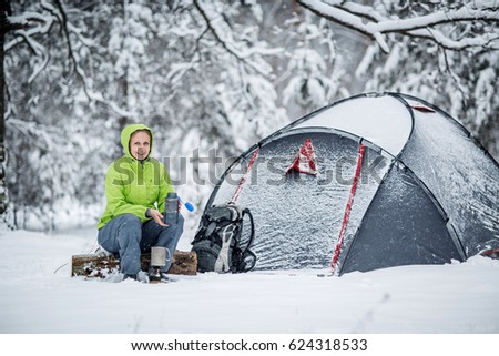 Happy woman cooking near winter tent c& in the snow forest. Bushcraft survival and & Happy Woman Cooking Near Winter Tent Stock Photo 624152570 ...