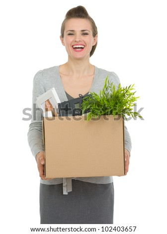 Happy woman employee holding box with personal items