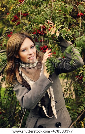 Happy Woman in Autumn Park. Fashion Model Outdoors.