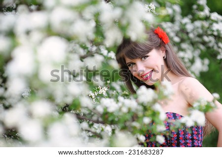 happy woman in the spring, in the lush garden.