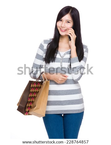 Happy woman shopping with mobile phone