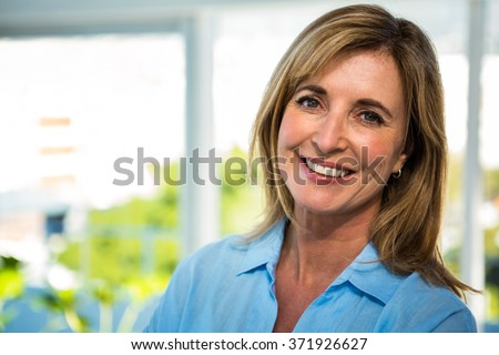 happy woman smiling at the camera