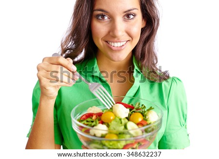 Happy woman with fork going to eat vegetable salad