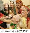Happy women drinking champagne - stock photo