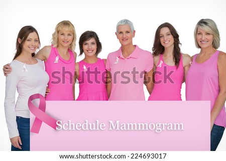 Happy women wearing pink for breast cancer awareness against pink card