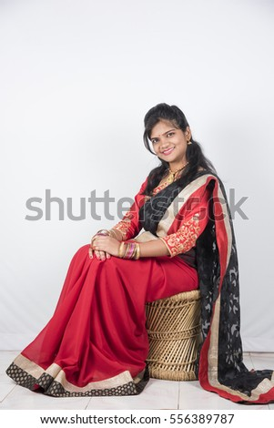 Happy young beautiful traditional Indian woman in saree.
