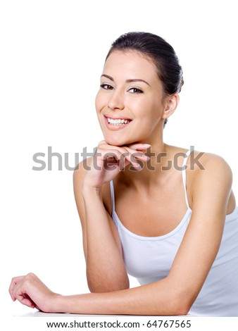 Happy young beautiful woman sitting with cheerful smile - isolated on white
