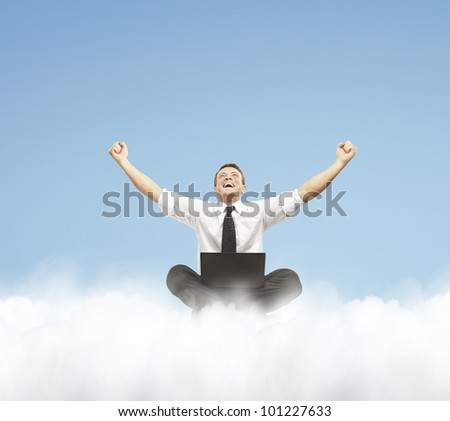 Happy young businessman with laptop sitting on the cloud.