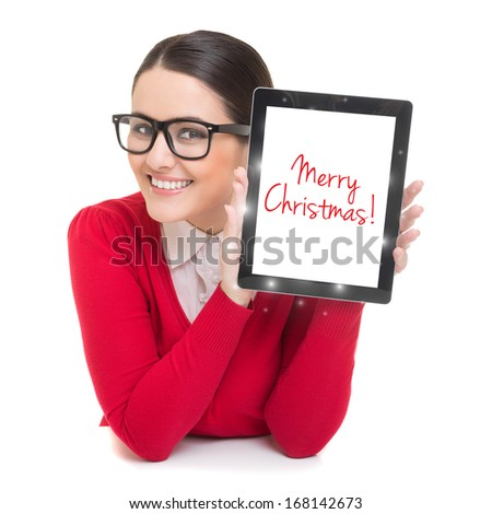 Happy young businesswoman with tablet computer wishing Merry Christmas. Christmas and technology concept.