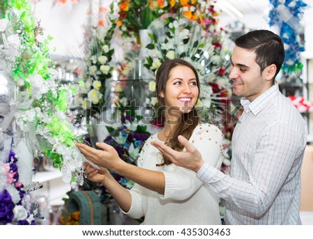 Happy young couple in a flower shop