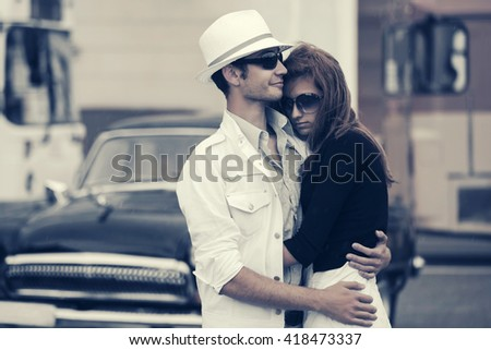 Happy young couple in love. Male and female fashion model outdoor. Man and woman on city street