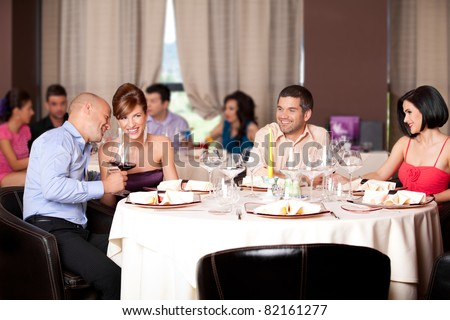 happy young couples talking restaurant table