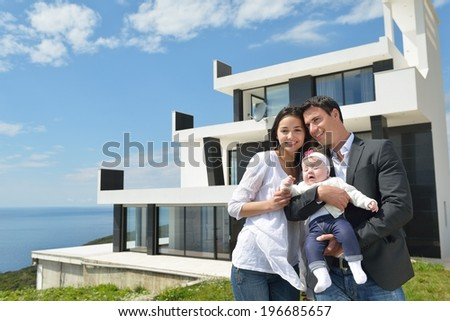 happy young family couple with beautiful new born baby have fun at home