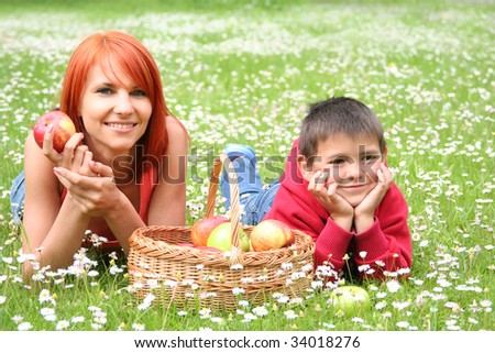 happy young family relaxing on a meadow
