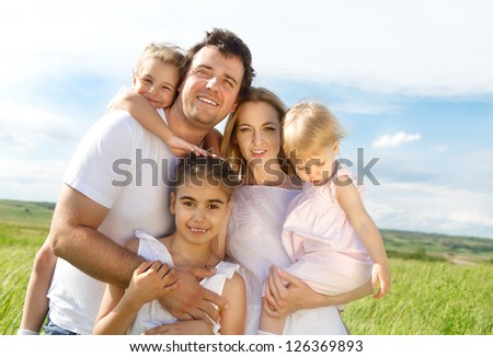 Happy young family with three children outdoors