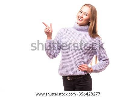 Happy young girl present invisible product in studio  on white background