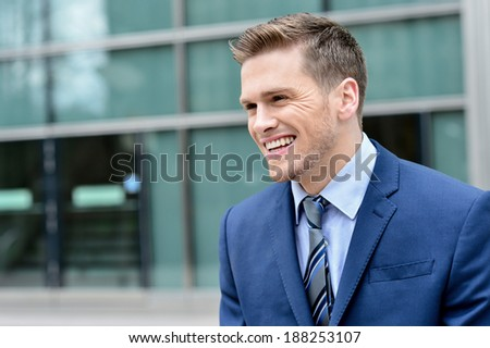 Happy young handsome businessman at outdoor