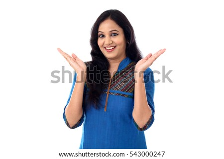 Happy young Indian woman against white background