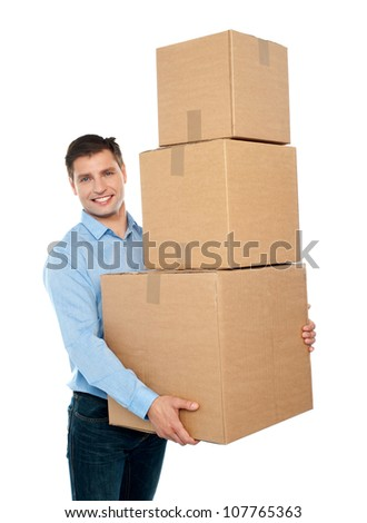 Happy young man carrying heavy packages against white background
