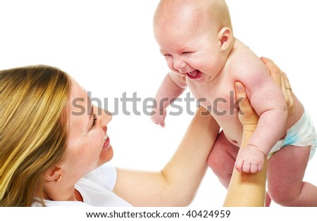 happy young mother playing with her baby boy; closeup faces