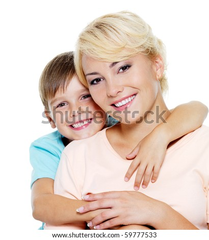 Happy young mother with son of six years. On white background
