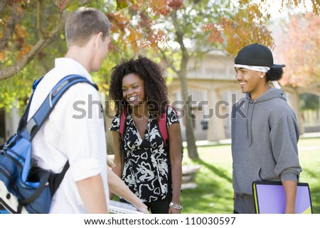 Happy young multiethnic friends in college campus
