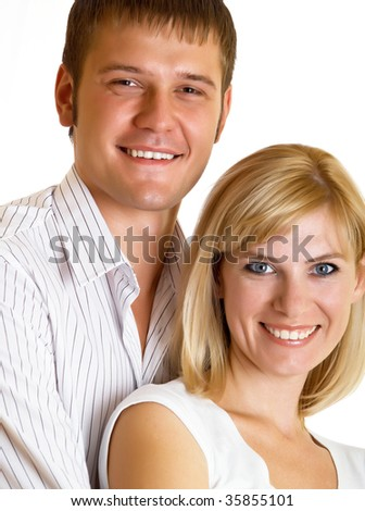 Happy young pair pose on a white background