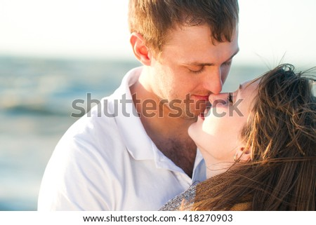 Happy young romantic couple in love have fun on beautiful beach at beautiful summer day. Close Up
