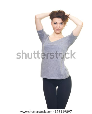 Happy young woman in a gray shirt with hands up. Isolated on white background