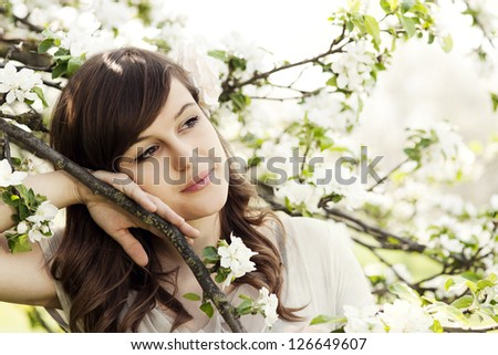 Happy young woman in the orchard