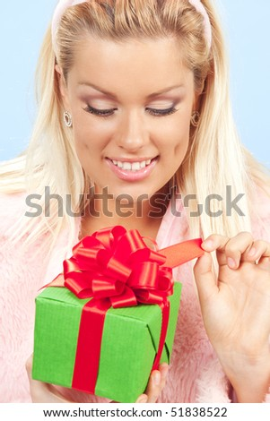 happy young woman opening present