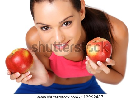 happy young woman sitting on the floor with apples isolated on white