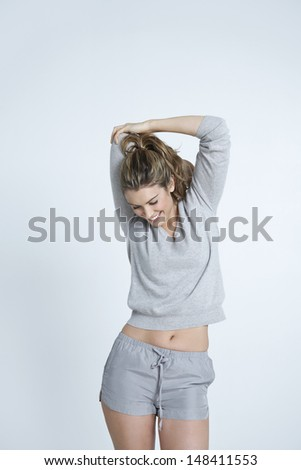 Happy young woman stretching hand isolated over colored background