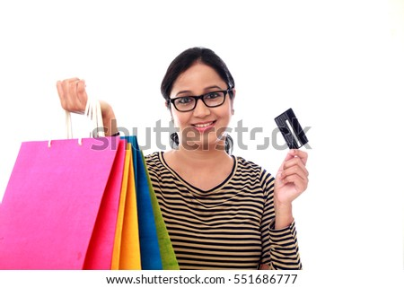 Happy young woman with shopping cards and debit card-Cashless purchase