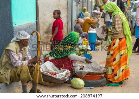HARAR, ETHIOPIA - JULY 26,2014 - People sell vegetables on the streets of Jugul, the fortified historic walled city on UNESCO's World Heritage List, and considered as the fourth holy city of Islam.
