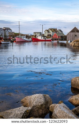 Harbor at Peggy's Cove, Nova Scotia, showing several boats tied up by the wharf.