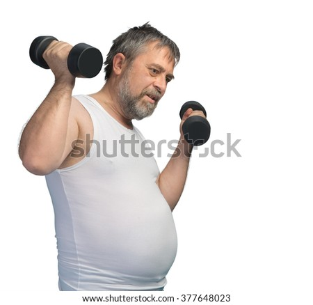 Hard work for a healthy lifestyle concept. Fat middle-aged man with a big belly does physical exercises with dumbbells isolated on white with copyspace