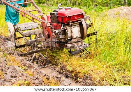 hard working farmer preparing the ground for the growth of rice in the north east of thailand