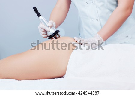 Hardware cosmetology. Concept picture of female buttocks getting rf lifting procedure in a beauty parlour.