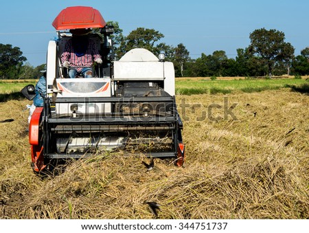 Harvesters on rice field old