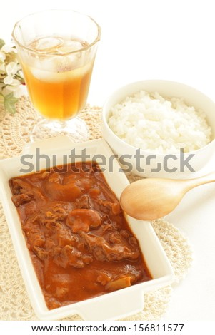 hashed beef, stew and bowl of rice with iced tea on background