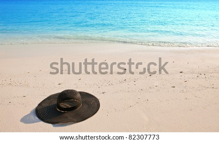 Hat from the sun  lie on sand.