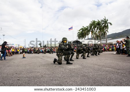 HATYAI THAILAND - JANUARY 10 :Children day, Show soldiers firing guns in the children's day at Royal Thai Army on January 10, 2015 in Hatyai Thailand.