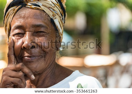 HAVANA,CUBA- AUGUST 9,2015: Cuban Afro Caribbean woman in Old Havana. People are friendly and an attraction for photographers.Old Havana is a Unesco World Heritage Site and a major tourist landmark