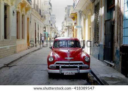 Havana, Cuba - March 2, 2016 : Big old American cars are  common sight in the backstreets of Havana
