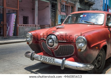 HAVANA, CUBA - MAY 31, 2014: Front view of a red Bullet Nose Studebaker in the streets of the Old Havana