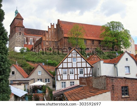 Havelberg with its Cathedral above the town. Down below old houses and gardens. Saxony-Anhalt, Germany.