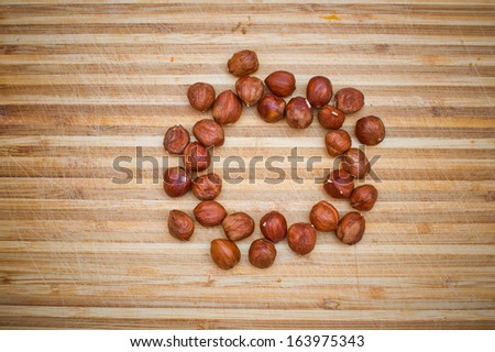 Hazelnuts on wooden desk background