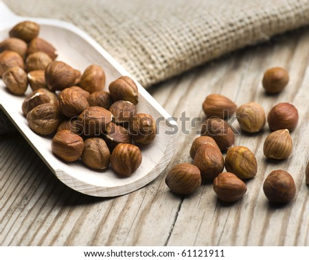 Hazelnuts Spilling Off A Wooden Food Scoop